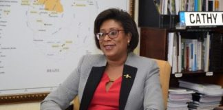 Hon. Catherine Hughes Minister of Public Telecommunications.